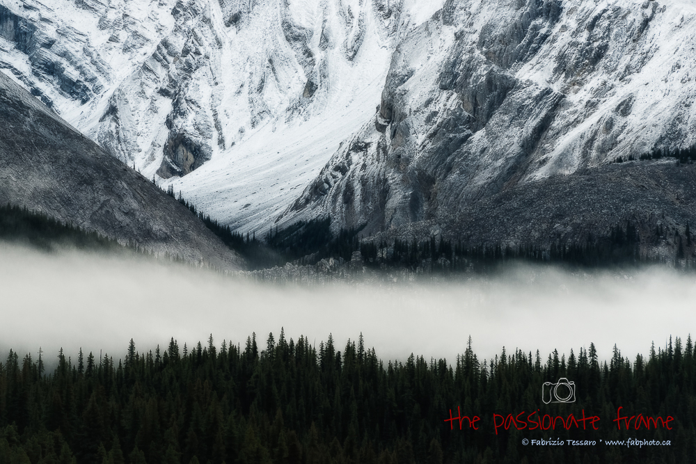 A fresh morning as the low clouds make there way across mountains at Maligne Lake in Jasper National Park, Alberta, Canada.