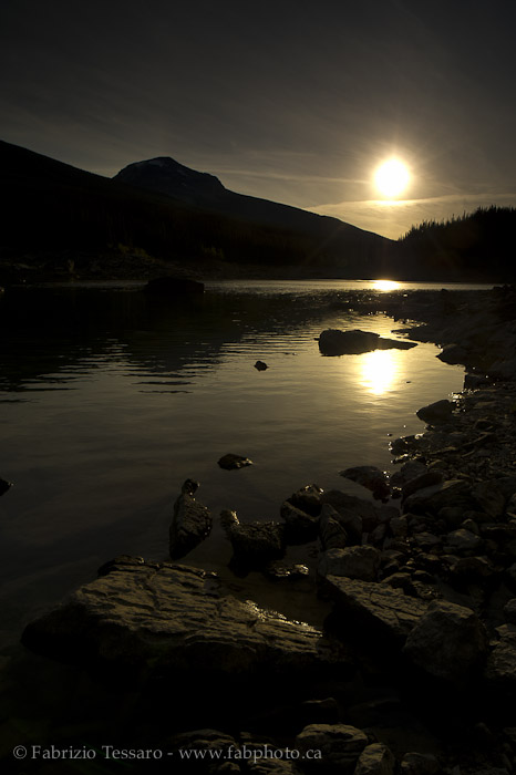 SUN SETTING on MEDICINE LAKE, Jasper National Park, Alberta, Canada, photo